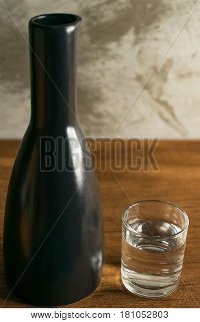 alcohol japannese whisky sake on table wood in front of concrete blur bacground