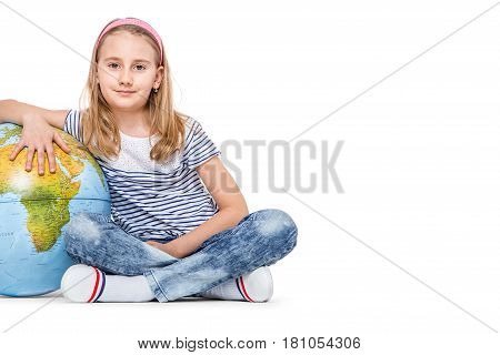 Cute little student girl with globe. School Education Concept.