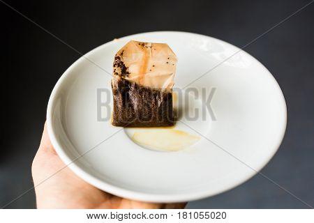 Used Tea Bag on White plate. Tea drinking