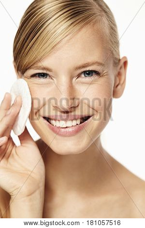 Beauty regime for blond woman portrait studio