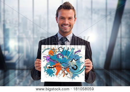 Digital composite of Portrait of smiling businessman holding colorful billboard in office