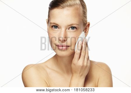 Beauty care woman using cotton pad portrait