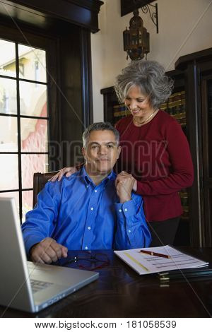 Multi-ethnic couple holding hands