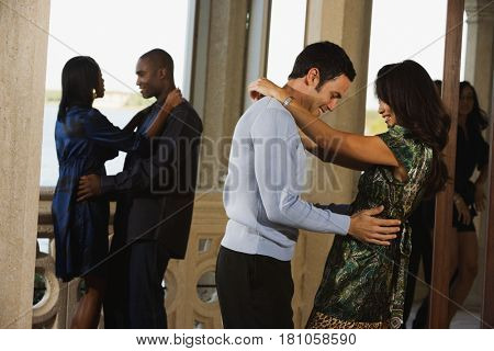 Multi-ethnic couples dancing at party