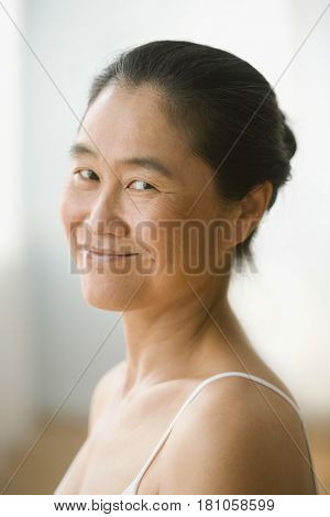 Close up of Asian woman smiling