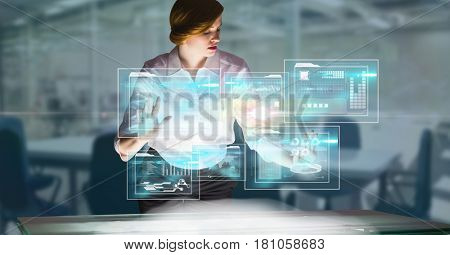 Digital composite of Digitally generated image of businesswoman touching futuristic screen in office