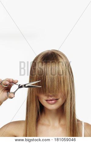 Beautiful blond about to cut fringe studio