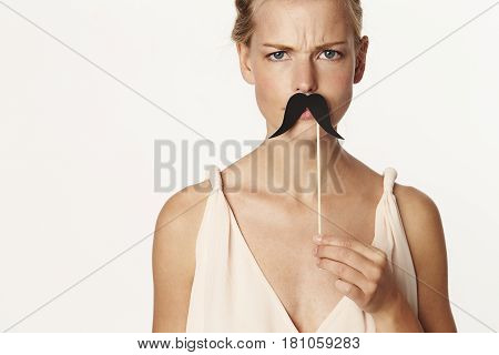 Young Beautiful blond holding mustache disguise portrait