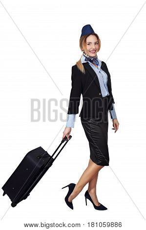 Beautiful young stewardess with a bag. Isolated on white background