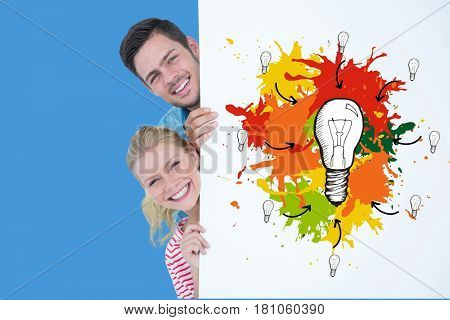 Digital composite of Happy couple behind bill board with bulbs drawn on it