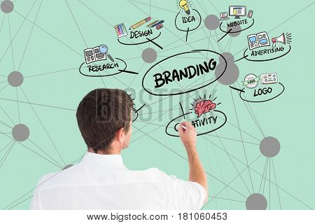 Digital composite of Digital composite image of businessman planning of product branding