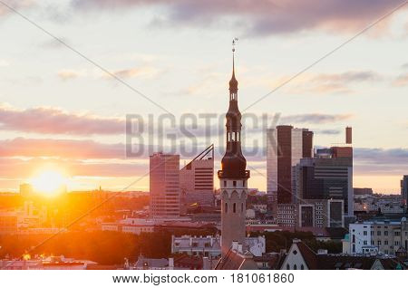 Wonderful sunrise over townhall and modern buildings Tallinn Estonia