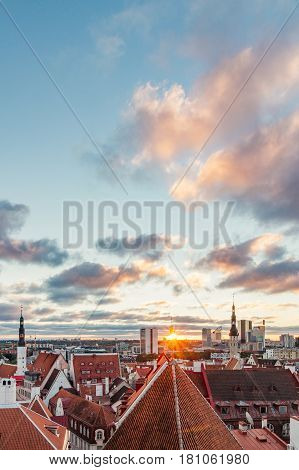 Morning sunrays over old town and modern buildings Tallinn Estonia