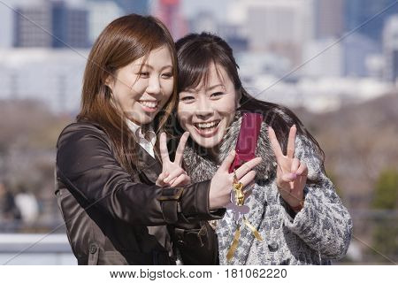 Asian women taking own photograph