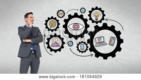 Digital composite of Digital composite image of happy businessman looking at gears and icons