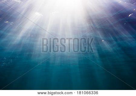 Sun rays in underwater. Ocean pattern in water