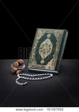Holy Quran Book With Rosary And Dates