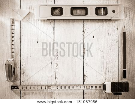 tools and instruments on wooden background