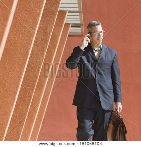 Businessman wearing hands-free device