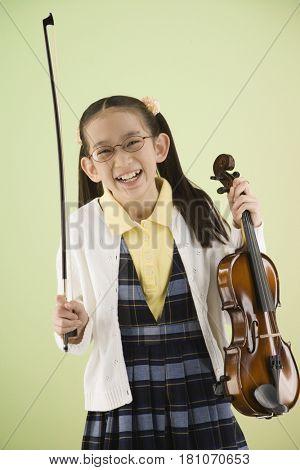 Asian girl holding violin