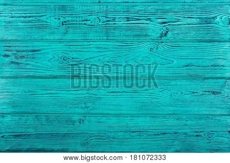 Turquoise textured wooden table. Brashing. Wooden background