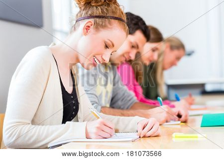 University college students writing test or exam