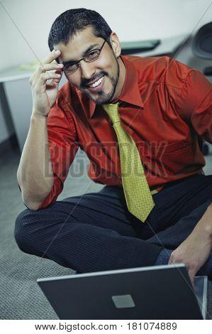 Hispanic businessman next to laptop
