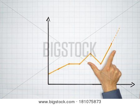 Businessman points an a chart on a flip chart - can be used for business oder presentation concepts with plenty copyspace