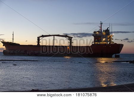 The rescue operations of an aground cargo ship