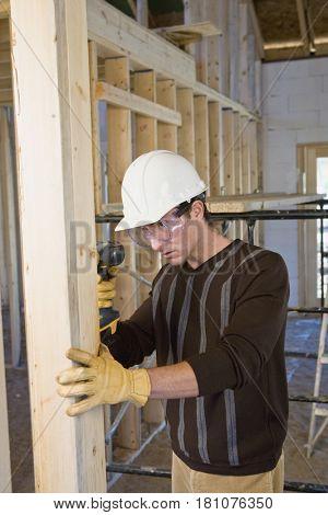 Hispanic man working at new construction site