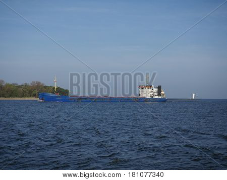 bulk carrier on a blue sky background