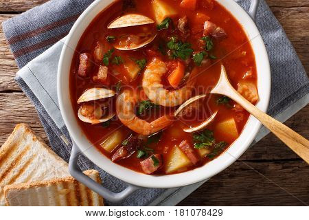 Manhattan Tomato Clam Chowder Soup Close-up In A Saucepan. Horizontal Top View
