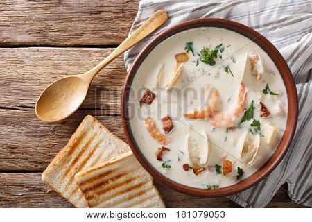 American Cuisine: New England Clam Chowder Soup Closeup. Horizontal Top View