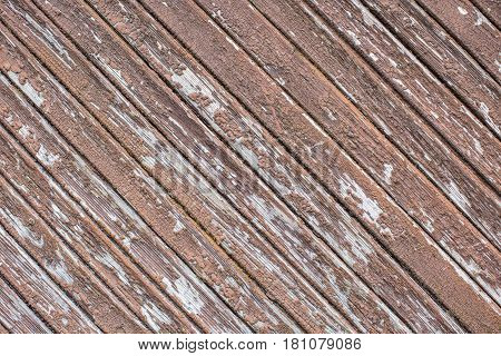 weathered cracked wood planking wall with peeling paint, abstract background