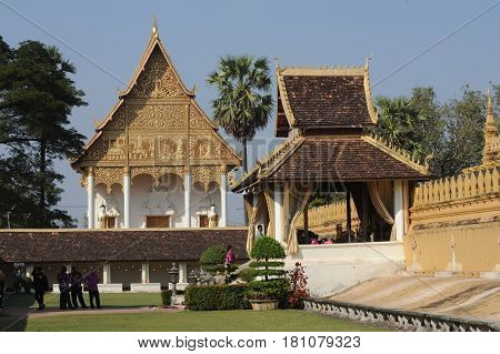 Vientiane, Laos - 18 January 2012: Golden pagoda wat Phra That Luang in Vientiane, Laos