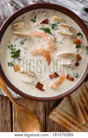 New England Clam Chowder Soup Close-up. Vertical Top View