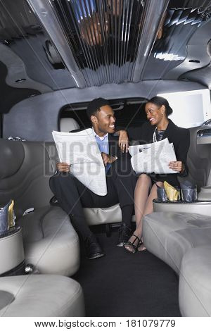 African businesspeople in limousine
