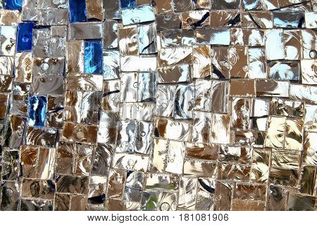 Detail of a beautiful crumbling abstract glass mosaic decoration. Stained-glass window. Leaded pane or panel. Glass painting. Decorative background. Selective focus. Closeup macro view. Horizontal.