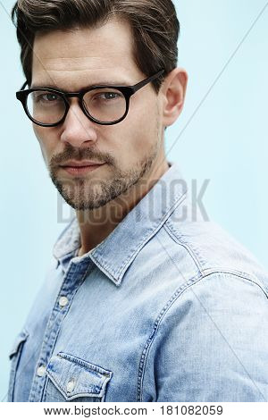 Portrait of bespectacled guy close up outdoor portrait