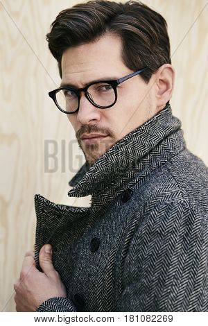 Cool guy in glasses and coat portrait