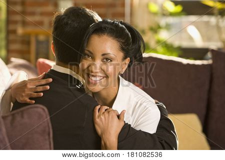 Mixed race couple hugging