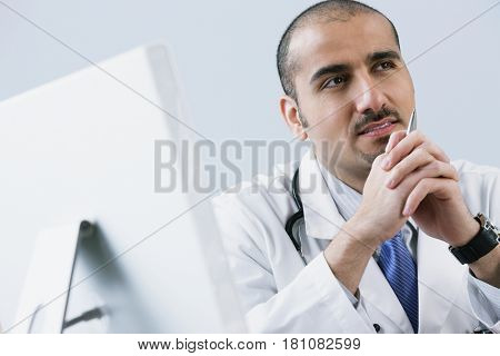 Lebanese male doctor thinking