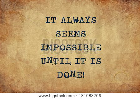 Inspiring motivation quote of it always seems impossible until it is done with typewriter text. Distressed Old Paper with Typing image.