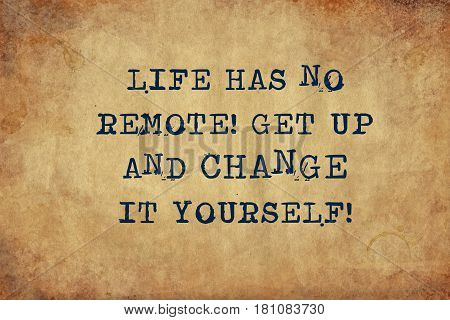 Inspiring motivation quote of life has no remote get up and change it yourself with typewriter text. Distressed Old Paper with Typing image.