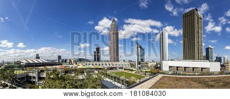 FRANKFURT GERMANY - APR 6 2017: Tower Messeturm and the Marriott hotel next to Frankfurt Trade Fair Grounds seen from the roof garden of Skyline Plaza Mall.