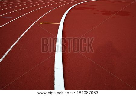 Curve on a red running track. Sport background