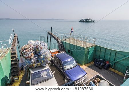 Ferry With Loading Platform And Cars, Cars Are Loaded With Cans Of Iron Sheet For Recycling