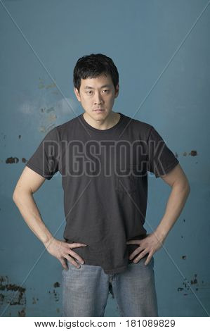 Angry Korean man with hands on hips