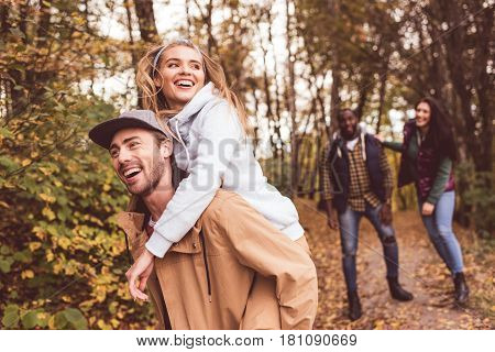 Happy Friends Having Fun In Forest