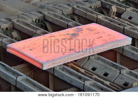 Hot slab inside of steel plant on conveyor